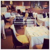 Photo taken at Signature by Andre V. on 12/15/2014