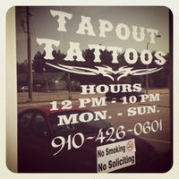 Photo taken at Tapout Tattoos by Elizabeth B. on 9/26/2012