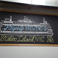 Photo taken at Flagship Brewing Co. by Alex Z. on 5/24/2014