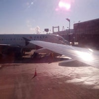Photo taken at Gate D2 by Martha M. on 2/19/2014