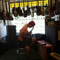 Photo taken at Rufus Guitar Shop by Dana A. on 7/26/2014