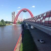 Photo taken at Zhivopisny Bridge by Margo on 6/3/2013