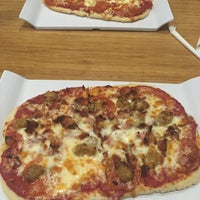 Photo taken at Green Zone Pizza by Brad D. on 9/18/2015