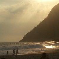 Photo taken at Praia de Itacoatiara by Thiago G. on 12/30/2012