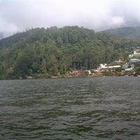 Photo taken at Telaga Sarangan by Dewi K. on 2/3/2013