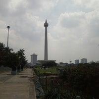 Photo taken at Lapangan Silang Monas by Des K. on 2/10/2013