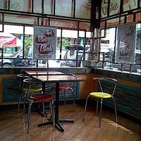 Photo taken at Smart Café by Regina C. on 4/8/2013