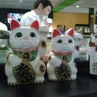 Photo taken at Sushi Train by Geoff S. on 2/16/2013