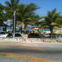 Photo taken at Praia Grande by Adan D. on 2/16/2013