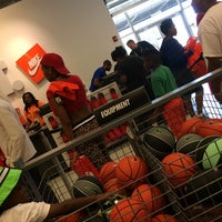 Photo taken at Nike Factory Store by Marsha E. on 7/4/2014