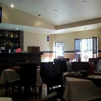 Photo taken at Restaurante El Rescoldo by Gregorio C. on 7/1/2013