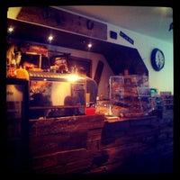 Photo taken at Kahwa Café by Nikolas C. on 9/30/2012