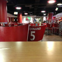 Photo taken at Manchester United Red Café by Majid on 3/6/2013