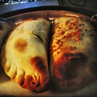Photo taken at Nuchas Artisan Empanadas by Jon E. on 1/17/2013