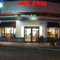 Photo taken at Five Guys by J V. on 11/28/2012