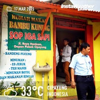 Photo taken at Warung Makan Sop Iga Sapi Bambu Kuning by Eshape B. on 3/17/2015