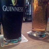 Photo taken at John Mullins Irish Pub by Kevin P. on 5/12/2013