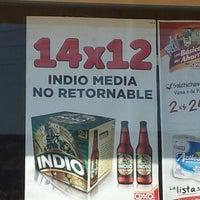 Photo taken at Oxxo Burgos by Alex R. on 12/24/2012