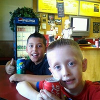 Photo taken at Woody's Pizza & Wings by Sanchia T. on 10/22/2012