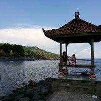 Photo taken at Pantai Candidasa by Yosep D. on 3/29/2015