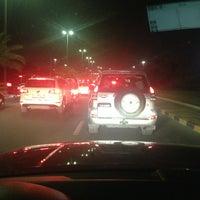 Photo taken at Mishref & South Surra Bridge's Traffic Light by DaLaLii A. on 7/15/2013