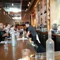 Photo taken at Plum Bar + Restaurant by Robert H. on 7/24/2013