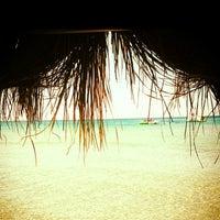 Photo taken at Fun Beach Club by BARIS E. on 7/26/2013