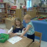 Photo taken at Riverside Branch Library by Jamie R. on 5/16/2013