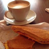 Photo taken at Buchi Cafe Cubano by Tika B. on 10/13/2013