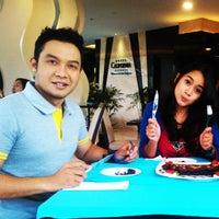 Photo taken at Garuda Indonesia Check In Counter @Kuta Paradiso Hotel by Hardiansyah A. on 1/29/2014
