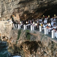 Photo taken at Grotta Palazzese by Katie F. on 8/11/2017