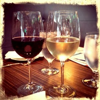 Photo taken at Bistecca Italian Steakhouse Wine Bar by Jim D. on 6/30/2014