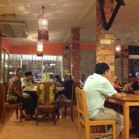 Photo taken at Dusun Bay Restaurant & Cafe by Sofea S. on 1/2/2013