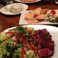 Photo taken at Outback Steakhouse by Anna W. on 5/28/2014