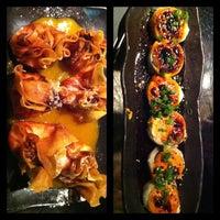 Photo taken at Dragonfly Sushi & Sake Co by Sasha S. on 1/29/2013