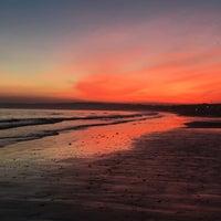 Photo taken at Swansea Bay Beach by Shaikha A. on 3/13/2016