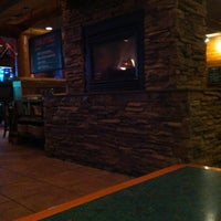 Photo taken at Smokey Bones Bar & Fire Grill by Melissa O. on 1/26/2013