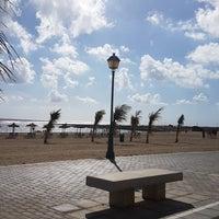 Photo taken at Playa del Castillo by Dominik K. on 12/21/2017