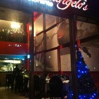 Photo taken at Michelangelo's Restaurant & Bar by Bong H. on 12/6/2012