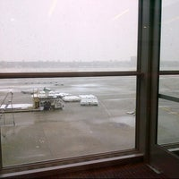 Photo taken at Gate A16 by Nadia on 3/6/2013