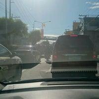 Photo taken at Dr. A. Santos Avenue (Sucat Road) by Quinn B. on 12/4/2015