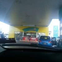 Photo taken at PETRONAS Station by Alexander H. on 1/27/2013