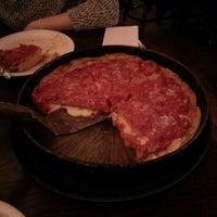 Photo taken at Lou Malnati's Pizzeria by Alex T. on 12/27/2012
