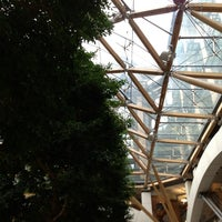 Photo taken at Portcullis House by Christopher W. on 12/18/2012