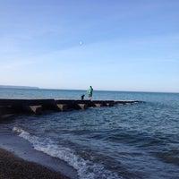 Photo taken at Big Bay Beach by Julia J. on 5/25/2014