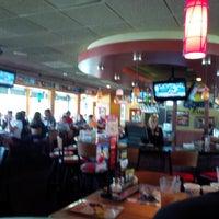 Photo taken at Applebee's Neighborhood Grill & Bar by Carlos M. on 8/19/2013