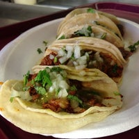 Photo taken at Tacos El Unico by Eric S. on 2/28/2013