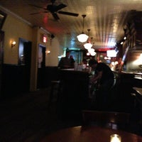 Photo taken at 11th Street Bar by W Archer N. on 1/30/2013