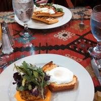 Photo taken at CAV Restaurant by Katie F. on 6/15/2013