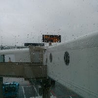 Photo taken at Gate D52 by Doug H. on 1/27/2013